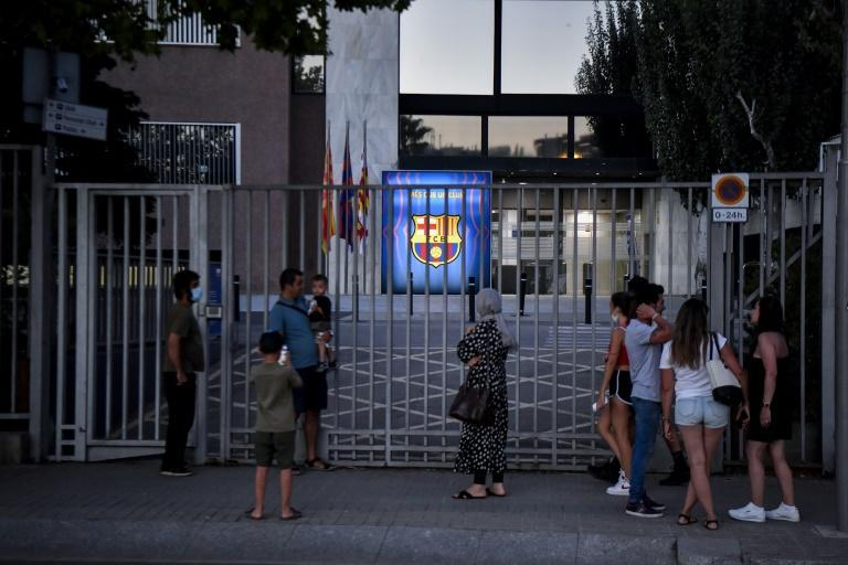 'Bombshell': Barcelona supporters gather in front of the Camp Nou stadium in Barcelona