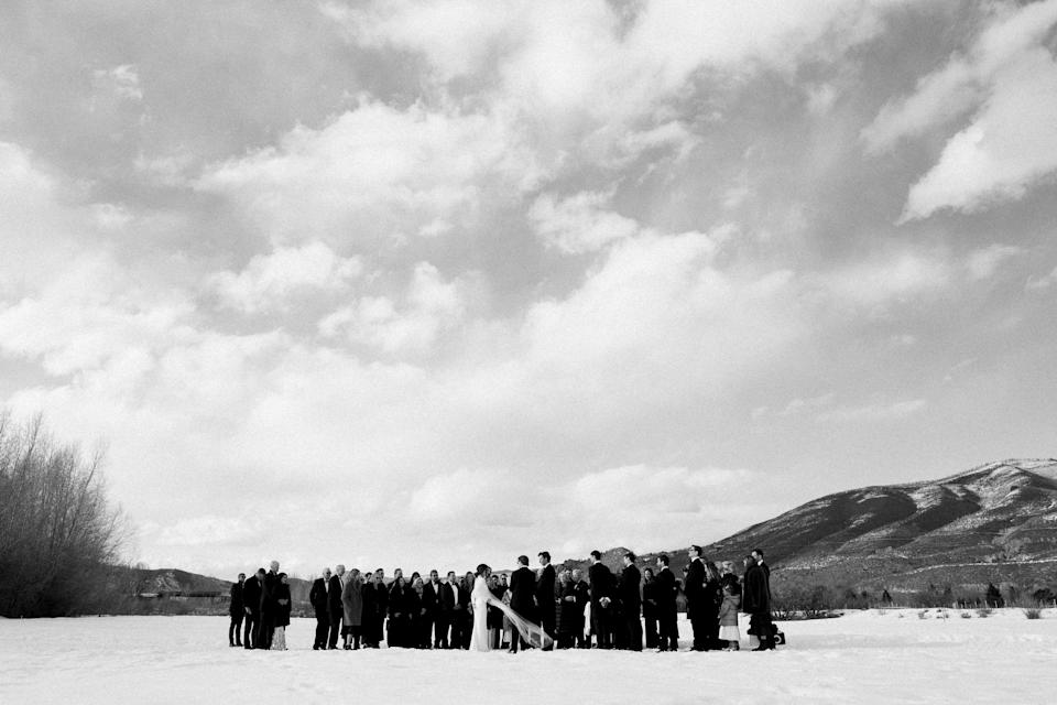 For us, this image captured everything. You wouldn't think this was a photo of a wedding party gathered in a field if not for the veil blowing in the wind. I love that subtlety. Our intention in getting married in Aspen was to be in the mountains and to nod to Peter's family's history there. And we wanted our closest friends to be there with us. Our original venue was 14 miles up a valley just outside of town. So it was important to us that we get married in a spot that would bring us close to the feel of that setting—removed, quiet, and beautiful.