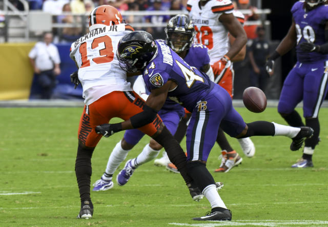 Cleveland Browns wide receiver Odell Beckham (13) is hit by Baltimore Ravens cornerback Marlon Humphrey (44) on Sunday. (Getty Images)