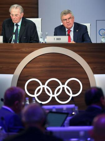 Thomas Bach, President of the International Olympic Committee (IOC), and former IOC President Jacques Rogge attend the 133rd IOC session in Buenos Aires, Argentina October 9, 2018. REUTERS/Marcos Brindicci