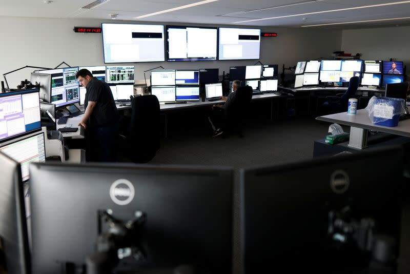 Satellite controller Sean Sauve and lead satellite controller Michael Arsenault work at the offices of Telesat in Ottawa