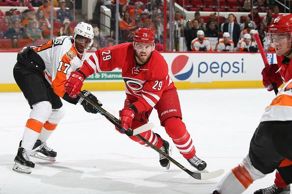 """<a class=""""link rapid-noclick-resp"""" href=""""/nhl/players/3814/"""" data-ylk=""""slk:Bryan Bickell"""">Bryan Bickell</a> of the <a class=""""link rapid-noclick-resp"""" href=""""/nhl/teams/car/"""" data-ylk=""""slk:Carolina Hurricanes"""">Carolina Hurricanes</a> skates for position off a face against the Philadephia Flyers on October 30, 2016 at PNC Arena in Raleigh, North Carolina. (Getty Images)"""