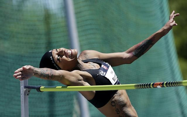 10ThingstoSeeSports - Inika McPherson goes over the bar to win the women's high jump with a leap of 6 feet 6 3/4 inches at the U.S. outdoor track and field championships, Sunday, June 29, 2014, in Sacramento, Calif. (AP Photo/Rich Pedroncelli, File)