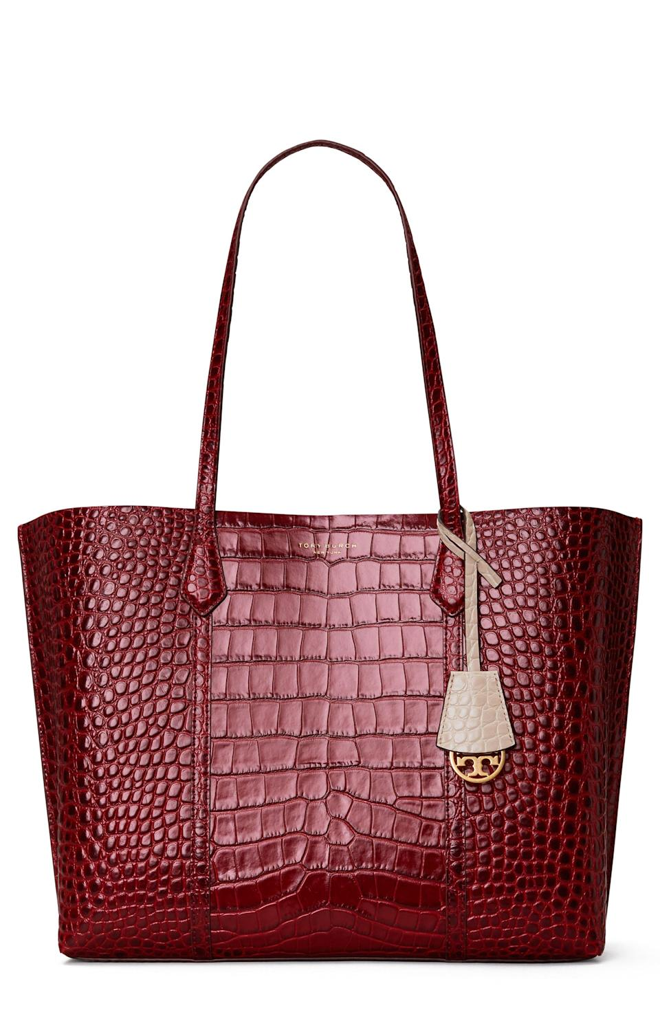 """<p><strong>TORY BURCH</strong></p><p>nordstrom.com</p><p><a href=""""https://go.redirectingat.com?id=74968X1596630&url=https%3A%2F%2Fwww.nordstrom.com%2Fs%2Ftory-burch-perry-croc-embossed-leather-tote%2F5707127&sref=https%3A%2F%2Fwww.townandcountrymag.com%2Fstyle%2Ffashion-trends%2Fg35967828%2Fnordstrom-spring-sale-2021%2F"""" rel=""""nofollow noopener"""" target=""""_blank"""" data-ylk=""""slk:Shop Now"""" class=""""link rapid-noclick-resp"""">Shop Now</a></p><p>$286.80</p><p><em>Original Price: $478</em></p>"""
