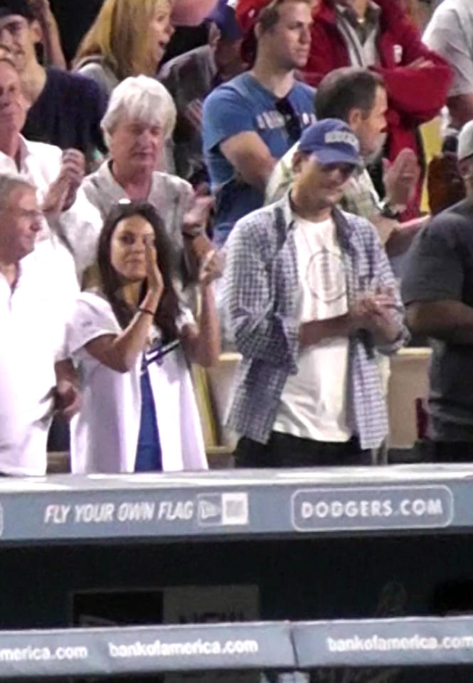 "No, they still haven't confirmed that they're dating, but Ashton Kutcher and Mila Kunis were perfectly comfortable showing the world they share a love of America's pastime, when the couple (or, according to them, the two friends) attended a Los Angeles Dodgers-San Francisco Giants game together at L.A.'s Dodger Stadium on Friday. They also took part in the age-old tradition of singing ""Take Me Out to the Ball Game."" (8/24/2012)"