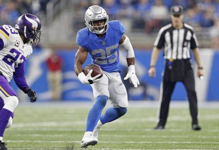 Nov 23, 2017; Detroit, MI, USA; Detroit Lions running back Theo Riddick (25) runs the ball during the third quarter against Minnesota Vikings cornerback Terence Newman (23) at Ford Field. Mandatory Credit: Raj Mehta-USA TODAY Sports