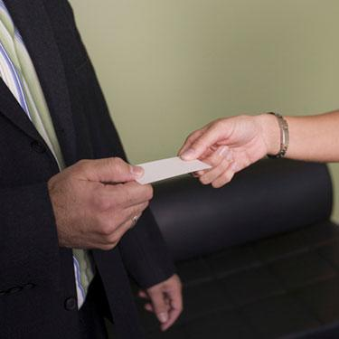 Businesswoman-giving-a-business-card-to-a-businessman_web