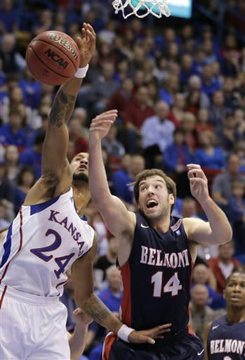 Kansas guard Travis Releford (24) beats Belmont guard/forward J.J. Mann (14) to a rebound during the first half of an NCAA college basketball game on Saturday, Dec. 15, 2012, in Lawrence, Kan. (AP Photo/Charlie Riedel)
