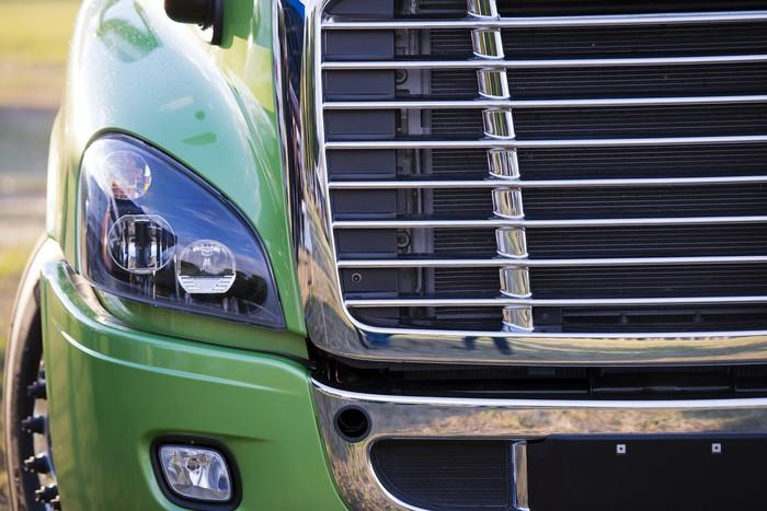 Detail of a grille and headlamp in a modern heavy duty semi truck.