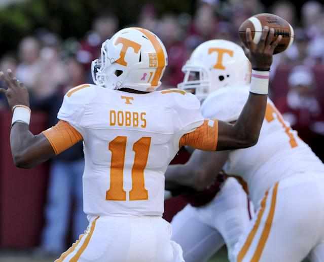 In this Oct. 26, 2013, photo Tennessee quarterback Josh Dobbs passes against Alabama during a NCAA football game in Tuscaloosa, Ala. (AP Photo/Michael Patrick, Knoxville News Sentinel)