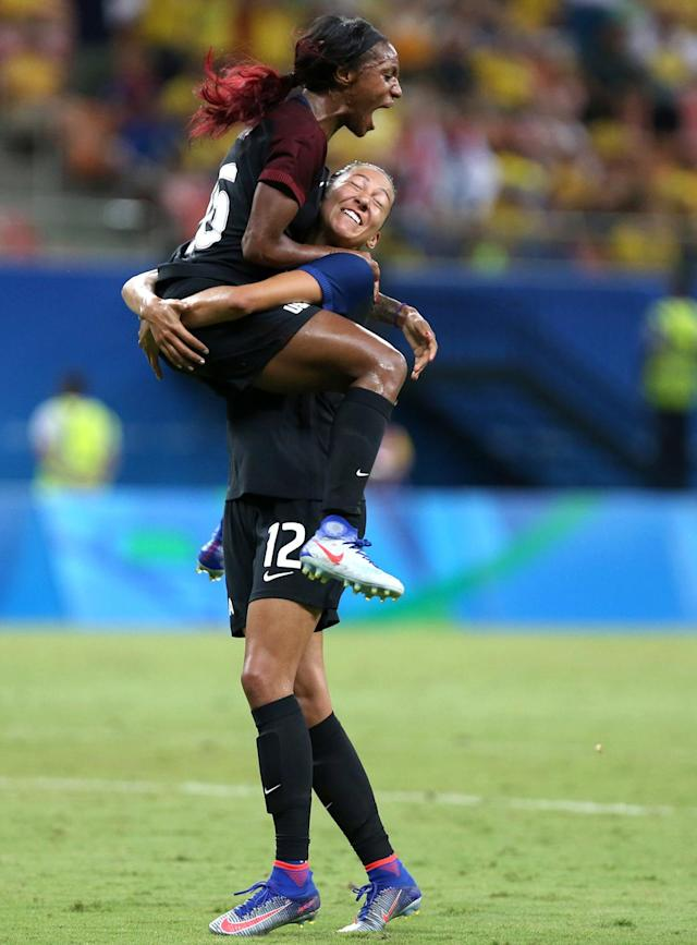 <p>United States' Crystal Dunn, top, celebrates scoring her side's first goal with teammate Christen Press during a group G match of the women's Olympic football tournament between Colombia and United States at the Arena Amazonia stadium in Manaus, Brazil, Tuesday, Aug. 9, 2016. The game ended in a 2-2 draw. (AP Photo/Michael Dantas) </p>