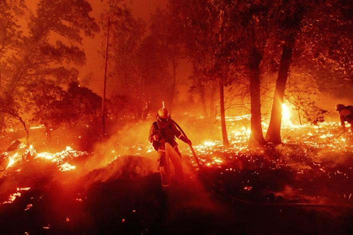 "A firefighter battles the Creek Fire in Madera County, Calif., which has burned more than 175,000 acres. <span class=""copyright"">(Noah Berger / Associated Press)</span>"