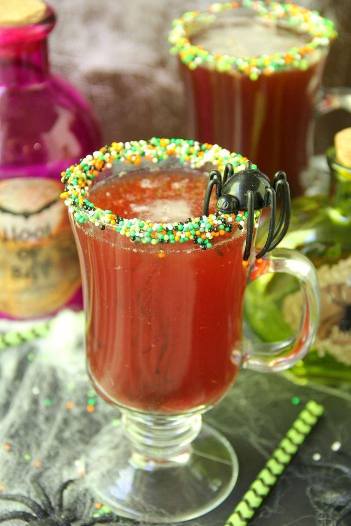 """<p> Rim each glass with corn syrup and then dip into the Halloween-colored sprinkles. Then, fill 1/3 of each glass with grape juice. Add 2 ounces of pineapple juice and finish off with lemon-lime soda. </p><p><em><br></em><em>Recipe from <a href=""""https://bitzngiggles.com/spooky-halloween-punch/"""" rel=""""nofollow noopener"""" target=""""_blank"""" data-ylk=""""slk:Bitz & Giggles."""" class=""""link rapid-noclick-resp"""">Bitz & Giggles.</a></em></p>"""