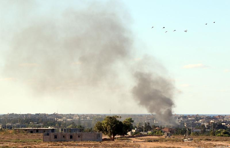 Smoke billows from buildings after the air force from the pro-government forces loyal to Libya's Government of National Unity fired rockets targeting Islamic State group positions in Sirte on July 18, 2016