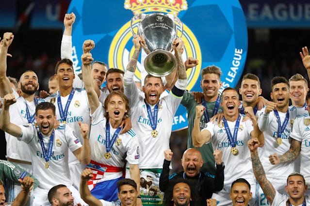 Soccer Football - Champions League Final - Real Madrid v Liverpool - NSC Olympic Stadium, Kiev, Ukraine - May 26, 2018 Real Madrid's Sergio Ramos lifts the trophy as they celebrate winning the Champions League REUTERS/Kai Pfaffenbach