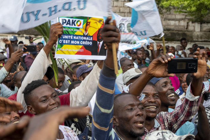 FILE - In this Friday March 19, 2021 file photo, supporters of opposition presidential candidate Guy Brice Parfait Kolelas cheer during their party's last rally of the presidential campaign in Brazzaville, Congo. Guy Brice Parfait Kolelas, the leading opposition presidential candidate in Republic of Congo, was receiving oxygen at a private hospital after being diagnosed with COVID-19, a family member said. The announcement late Saturday March 20, 2021 comes on the eve of the presidential election. (AP Photo/Christ Kimvidi, File)