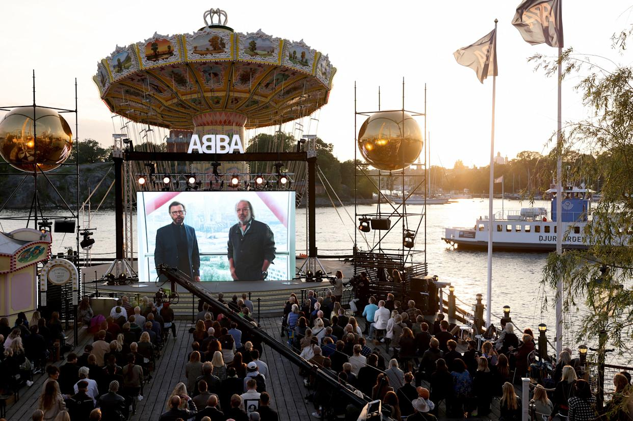 ABBA's Bjoern Ulvaeus and Benny Andersson are seen live on a display from London during their Voyage event at Grona Lund, Stockholm, on Sept. 2, 2021.T (Photo: Fredrik Persson/TT News Agency/AFP via Getty Images)