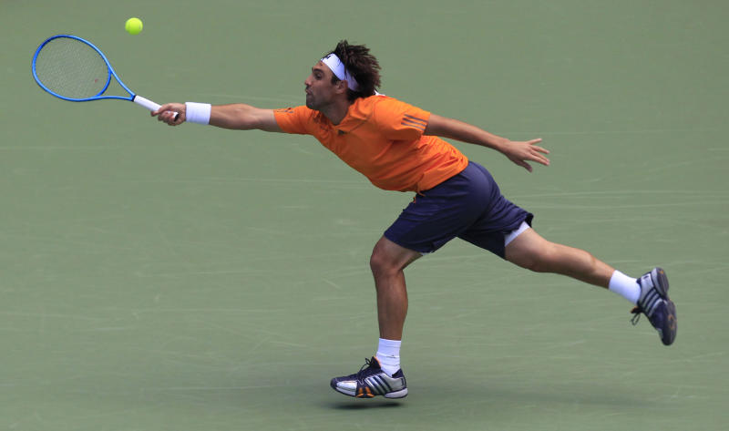 Marcos Baghdatis of Cyprus return a shot against Jo-Wilfried Tsonga of France during their third round match of the Shanghai Masters tennis tournament at Qizhong Forest Sports City Tennis Center in Shanghai, China, Thursday Oct. 11, 2012. Tsonga won 6-2, 7-6 (2). (AP Photo/Eugene Hoshiko)