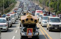 A convoy of mourners follows a hearse carrying the body of protestor Mya Thwate Thwate Khaing who has become a national symbol of resistance to the junta