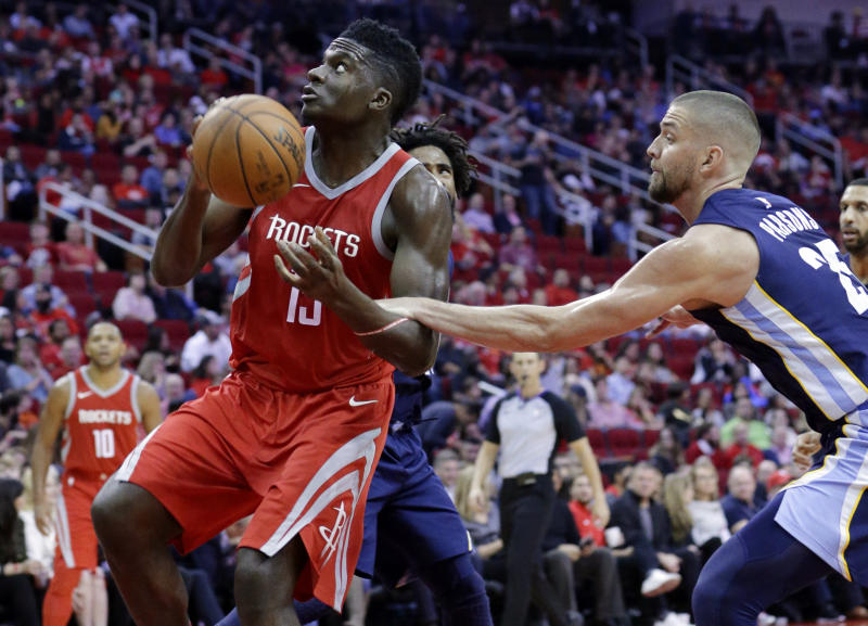 Houston Rockets center Clint Capela (15) is fouled as he goes for a shot by Memphis Grizzlies forward Chandler Parsons (25) during the second half of an NBA basketball game Saturday, Nov. 11, 2017, in Houston. (AP Photo/Michael Wyke)