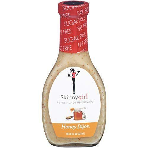"""<p><strong>Skinnygirl</strong></p><p>amazon.com</p><p><strong>$26.15</strong></p><p><a href=""""https://www.amazon.com/dp/B07B3ZC82X?tag=syn-yahoo-20&ascsubtag=%5Bartid%7C2140.g.26932031%5Bsrc%7Cyahoo-us"""" rel=""""nofollow noopener"""" target=""""_blank"""" data-ylk=""""slk:Shop Now"""" class=""""link rapid-noclick-resp"""">Shop Now</a></p><p>It's pretty hard to find a keto-friendly honey mustard dressing, but this one checks the box. The sugar-free salad dressing has only 3 grams of carbs per serving.</p><p><em>Per 2 ttbsp serving: 10 calories, 0 g fat (0g saturated), 3g carbs, 0g sugar, 240 mg sodium, 2g fiber, 0g protein </em></p>"""