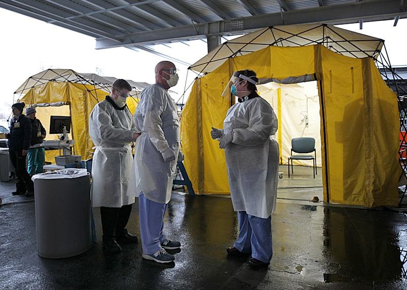 NEWTON, MA - MARCH 17: Medical professionals work in coronavirus testing tents at Newton Wellesley Hospital in Newton, MA on March 17, 2020. (Photo by Suzanne Kreiter/The Boston Globe via Getty Images)