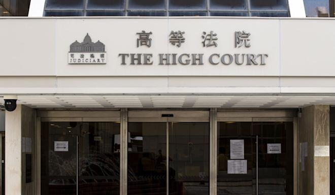 Hong Kong's High Court on Wednesday threw out activist Joshua Wong's attempt to overturn a ban on his running in last November's district council elections. Photo: Warton Li