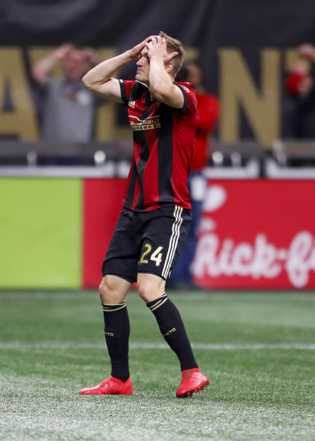Atlanta United defender Julian Gressel (24) reacts after missing a goal in the first half of an MLS soccer game against D.C. United, Sunday, March 12, 2018, in Atlanta. (AP Photo/Todd Kirkland)