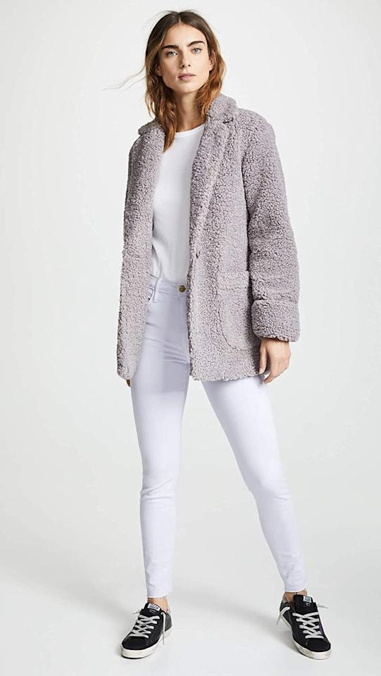 """<p>This fuzzy <product href=""""https://www.amazon.com/Laveer-Womens-Lilac-Purple-Small/dp/B07L386L7R/ref=sr_1_14?dchild=1&amp;keywords=shopbop+coats&amp;qid=1600806336&amp;sr=8-14"""" target=""""_blank"""" class=""""ga-track"""" data-ga-category=""""internal click"""" data-ga-label=""""https://www.amazon.com/Laveer-Womens-Lilac-Purple-Small/dp/B07L386L7R/ref=sr_1_14?dchild=1&amp;keywords=shopbop+coats&amp;qid=1600806336&amp;sr=8-14"""" data-ga-action=""""body text link"""">Laveer Jane Coat</product> ($198) also comes in black and pink.</p>"""