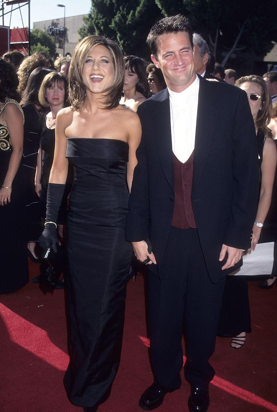 """<p>Jennifer Aniston wore a classic black dress when she walked the Emmys red carpet with her <em>Friends</em><span class=""""redactor-invisible-space""""> costar, Matthew Perry, in 1995. </span></p>"""
