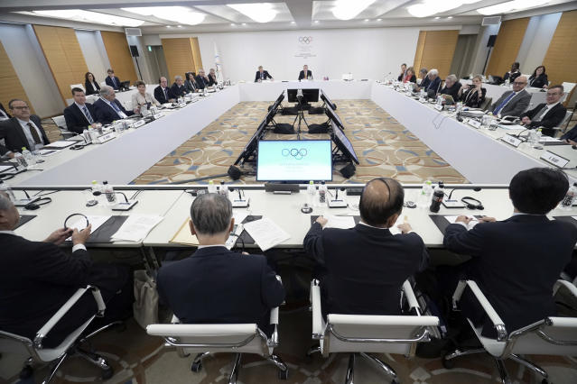 International Olympic Committee (IOC) President Thomas Bach, top center, and Tokyo Olympic organizing committee President Yoshiro Mori, bottom second from left, and Toshiro Muto, bottom second from right, CEO of the Tokyo Organizing Committee of the Olympic and Paralympic Games, attend an IOC Executive Board meeting Saturday, Dec. 1, 2018, in Tokyo. The IOC said boxing will take place at the 2020 Tokyo Olympics. But exactly who runs the tournament and the details of qualifying are up in the air because of charges of corruption and malfeasance surrounding the boxing federation that runs the sport at the Olympics. (AP Photo/Eugene Hoshiko)