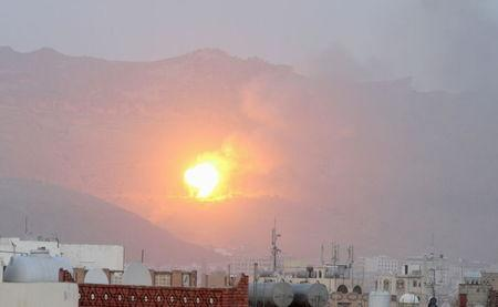 Fire is seen from the Noqum Mountain after it was hit by an air strike in Yemen's capital Sanaa May 19, 2015. REUTERS/Mohamed al-Sayaghi
