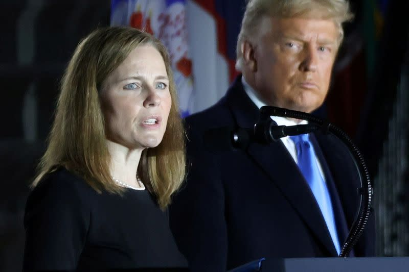 FILE PHOTO: U.S. President Trump looks on as Judge Barrett delivers remarks after she was sworn in as an associate justice of the U.S. Supreme Court at the White House in Washington