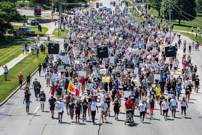 Marchers rally in Omaha, Nebraska, on June 7 to remember James Scurlock, a Black man who was fatally shot by white bar owner Jake Gardner amid protests over George Floyd's death. (Chris Machian/Omaha World-Herald via AP)