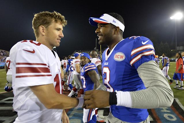 New York Giants quarterback Eli Manning (10) and Buffalo Bills quarterback EJ Manuel (3) talk after the Giants defeated the Bills 17-13 at the Pro Football Hall of Fame exhibition NFL football game Sunday, Aug. 3, 2014, in Canton, Ohio. (AP Photo/David Richard)