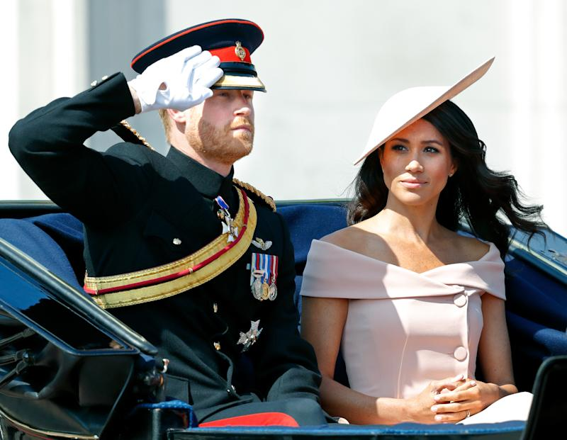 Prince Harry, Duke of Sussex and Meghan, Duchess of Sussex travel down The Mall in a horse drawn carriage during Trooping The Colour 2018 on June 9, 2018 in London, England. The annual ceremony, involving over 1400 guardsmen and cavalry, is believed to have first been performed during the reign of King Charles II. The parade marks the official birthday of the Sovereign, even though the Queen's actual birthday is on April 21st. (Photo by Max Mumby/Indigo/Getty Images)