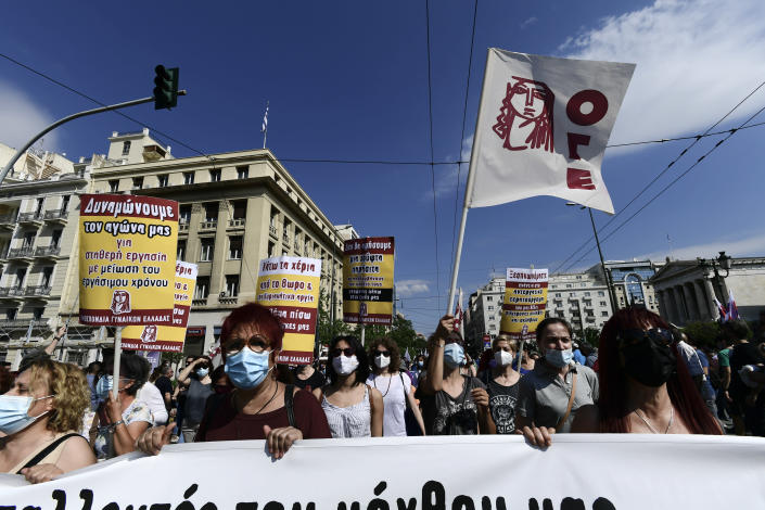 Protesters march to the parliament during a 24-hour labor strike in Athens, Thursday, June 10, 2021. Widespread strikes in Greece brought public transport and other services to a halt Thursday, as the country's largest labor unions protested against employment reforms they argue will make flexible workplace changes introduced during the pandemic more permanent. (AP Photo/Michael Varaklas)