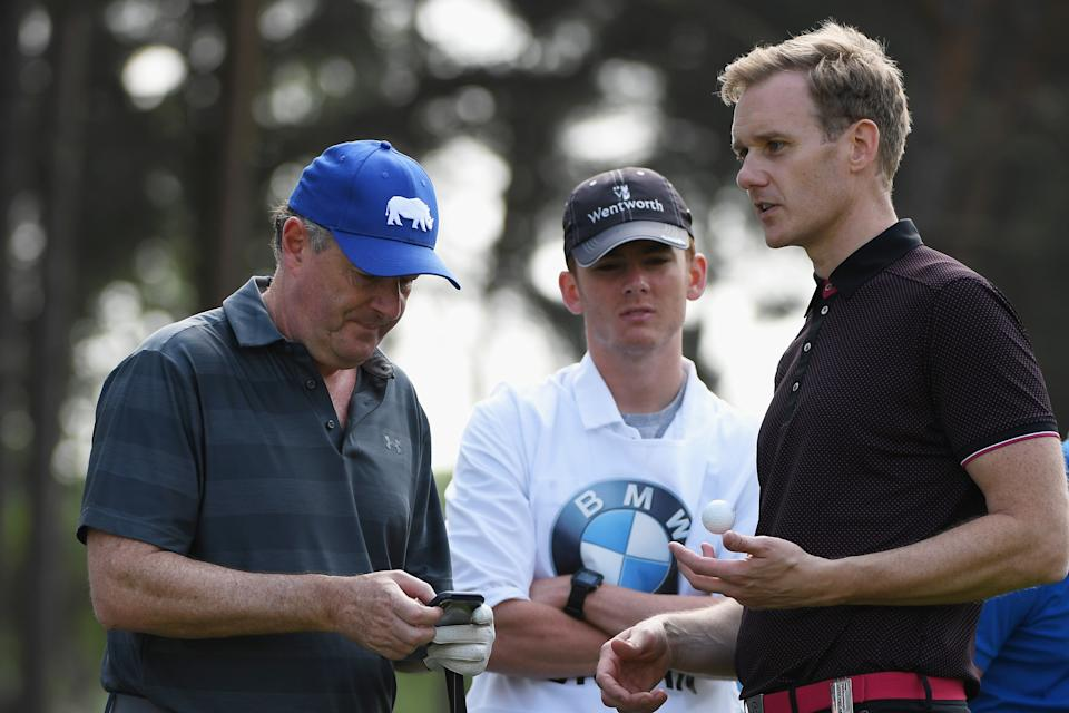 VIRGINIA WATER, ENGLAND - MAY 23:  Piers Morgan chats with Dan Walker during the Pro Am for the BMW PGA Championship at Wentworth on May 23, 2018 in Virginia Water, England.  (Photo by Ross Kinnaird/Getty Images)