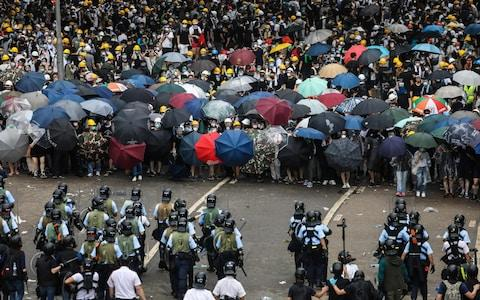 Protesters face off with police during a rally - Credit: DALE DE LA REY/AFP/Getty Images