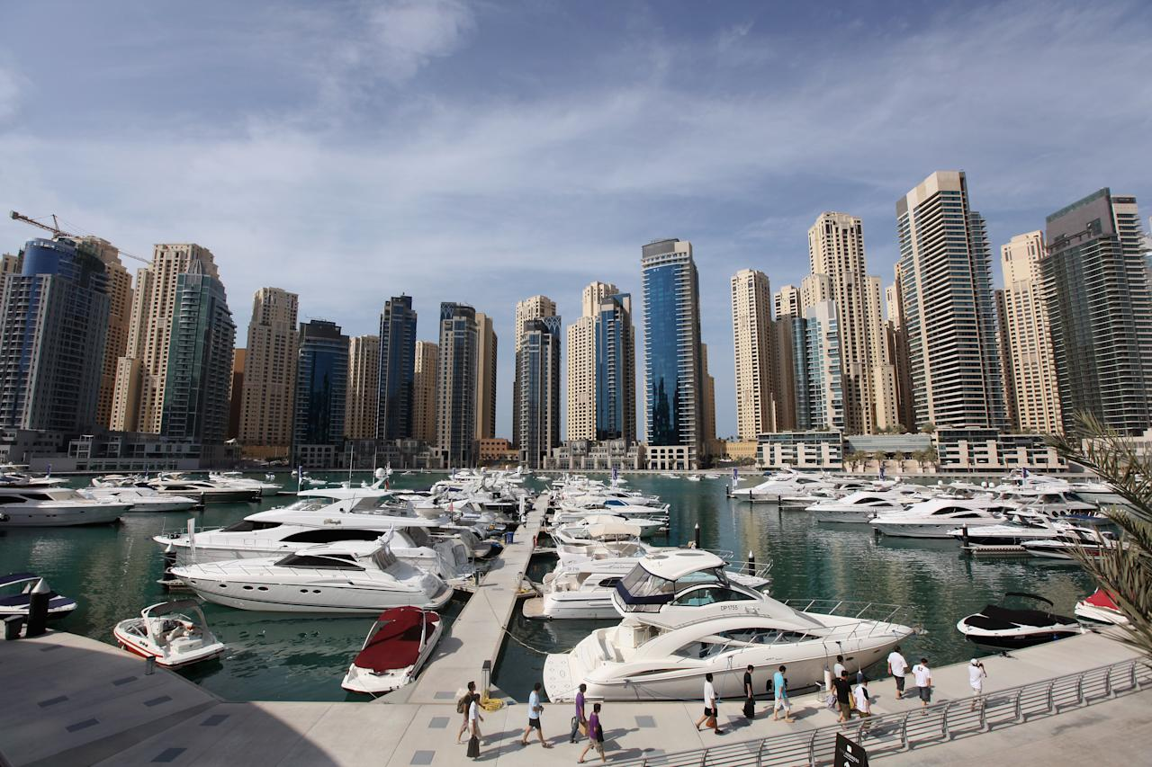 DUBAI, UNITED ARAB EMIRATES - DECEMBER 02: A general view of the newly developed Dubai Marina on December 2, 2009 in Dubai, United Arab Emirates. Stock markets in the Dubai and Abu Dhabi fell sharply this week after state owned company Dubai World asked for more time to pay off depts, amounting to 35Bn GBP. The Dubai economy which has enjoyed years of rapid growth has seen a sharp decline recently as world markets reacted to the global economic crisis. (Photo by Dan Kitwood/Getty Images)