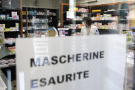 """FILE - In this Feb. 22, 2020, file photo, a note reading in Italian """"Masks sold out"""" hangs on the window of a pharmacy in Codogno, near Lodi, Northern Italy. Fear of the spreading coronavirus has led to a global run on sales of face masks despite medical experts' advice that most people who aren't sick don't need to wear them. (AP Photo/Luca Bruno, File)"""