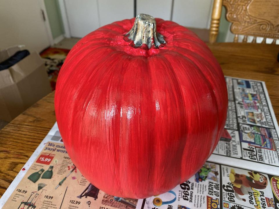 <p>After you get all of your supplies, the first thing you need to do is paint your pumpkin red. This may take a few thin coats of paint to get everything covered well and evenly.</p>