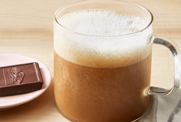 """<p>Need a cozy drink to pair with your breakfast? Skip the Starbucks drive-thru and make your own mocha at home. This lightened up version is dairy-free, enlists the help of real dark chocolate, and is best enjoyed under a soft blanket.</p><p><a href=""""https://www.prevention.com/food-nutrition/recipes/a25414583/healthy-mocha-latte-recipe/"""" rel=""""nofollow noopener"""" target=""""_blank"""" data-ylk=""""slk:Get the recipe »"""" class=""""link rapid-noclick-resp""""><strong><em>Get the recipe »</em></strong></a></p>"""