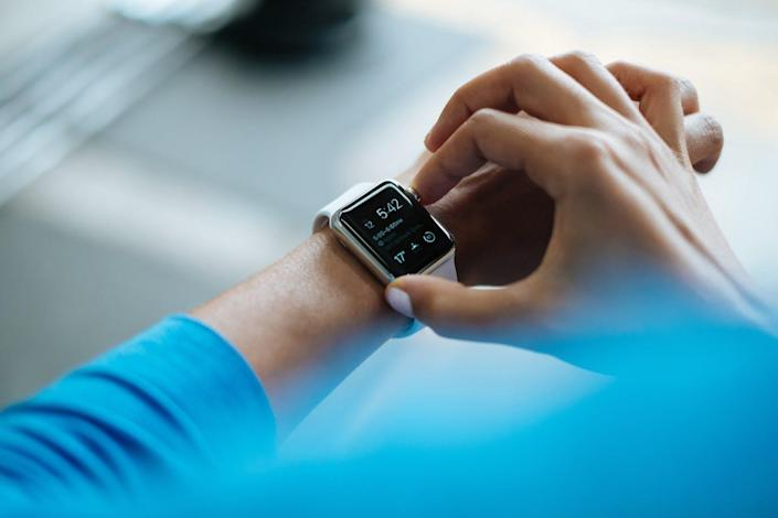 A person wearing a smart watch.
