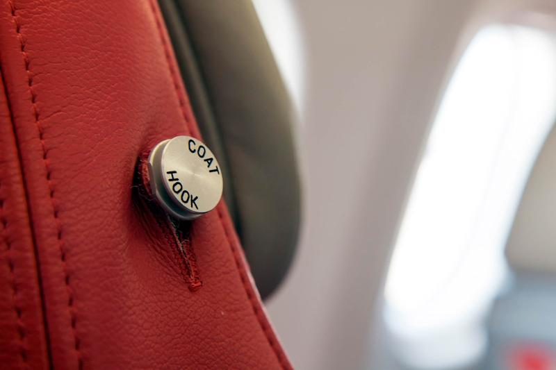 You've Probably Never Noticed These Hidden Coat Hooks on Airplanes Before