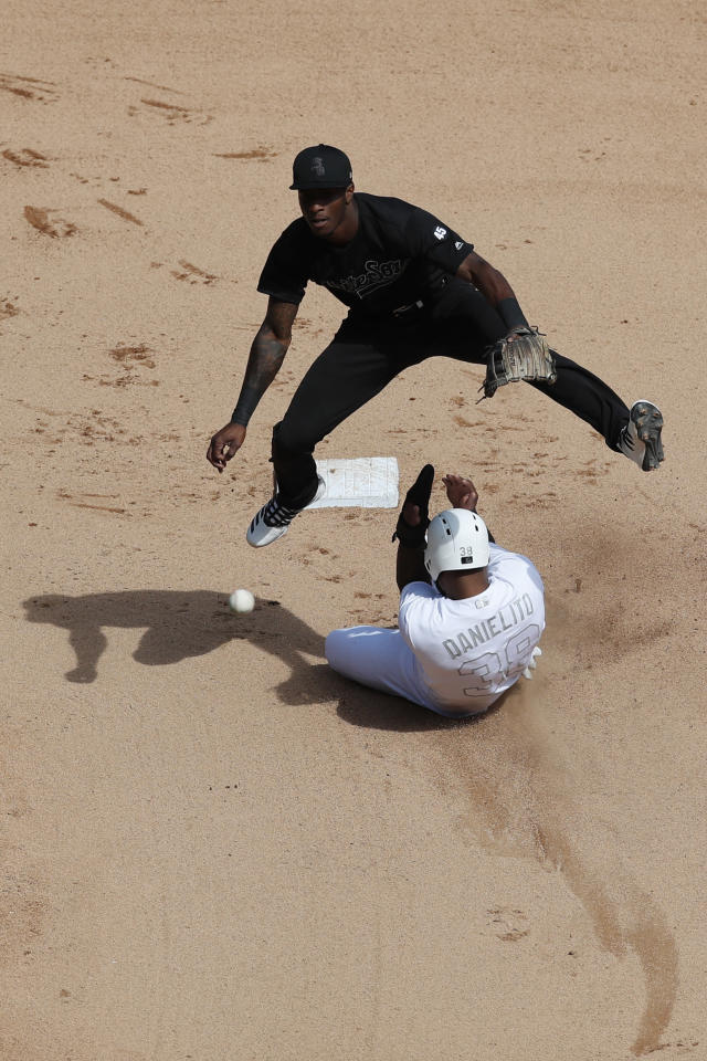Chicago White Sox shortstop Tim Anderson, top, leaps over Texas Rangers' Danny Santana (38) trying to turn a double play during the sixth inning of a baseball game Sunday, Aug. 25, 2019, in Chicago. (AP Photo/Jeff Haynes)