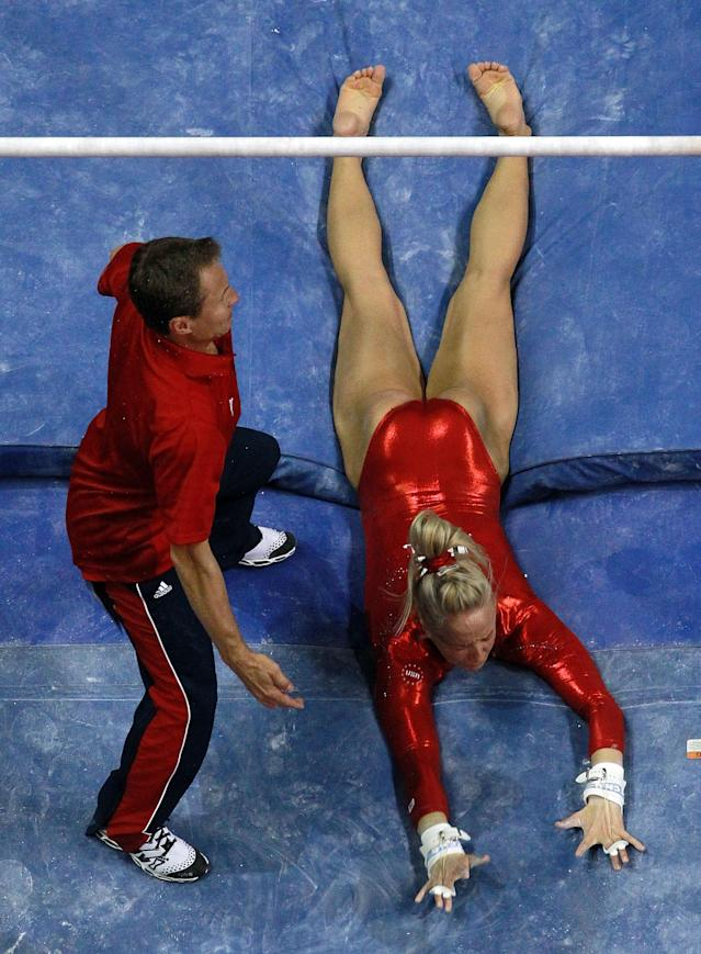 SAN JOSE, CA - JULY 01: Nastia Liukin falls off the uneven bars in front of coach, Valeri Liukin during day 4 of the 2012 U.S. Olympic Gymnastics Team Trials at HP Pavilion on July 1, 2012 in San Jose, California. (Photo by Ronald Martinez/Getty Images)