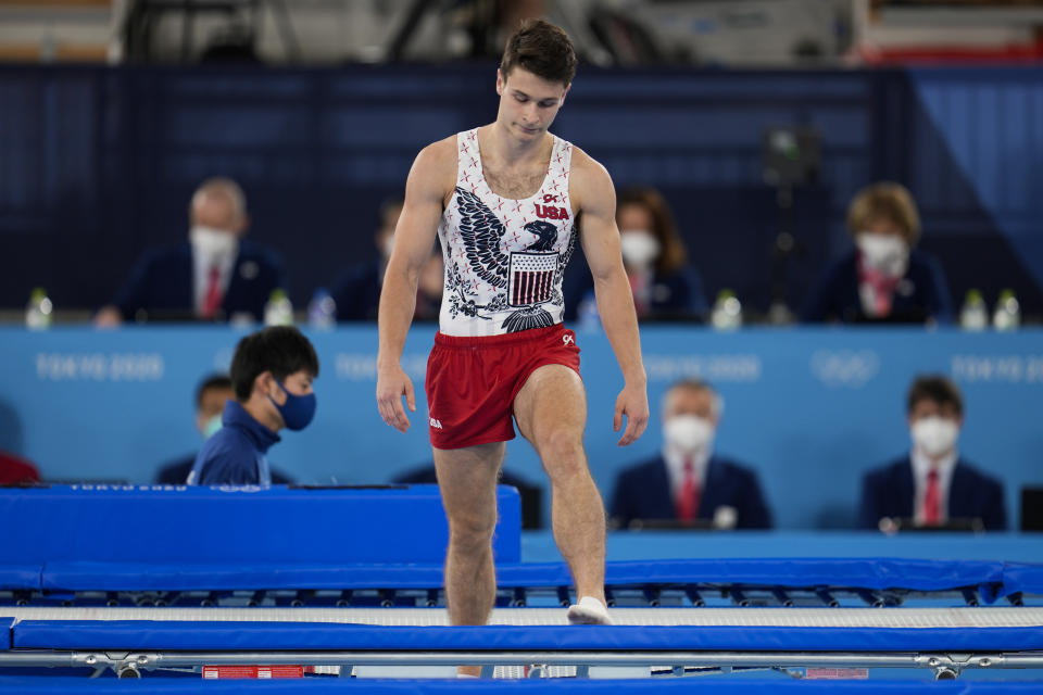 Aliaksei Shostak, of United States, reacts after falling during in the men's trampoline gymnastics qualifier at the 2020 Summer Olympics, Saturday, July 31, 2021, in Tokyo. (AP Photo/Natacha Pisarenko)