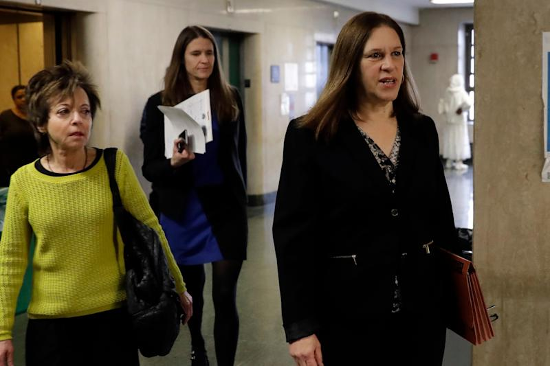 Manhattan Assistant District Attorney Joan Illuzzi, right, followed by ADA Meghan Hast, arrive for defense closing arguments at the Harvey Weinstein sex-crimes trial in New York, Feb. 13, 2020.