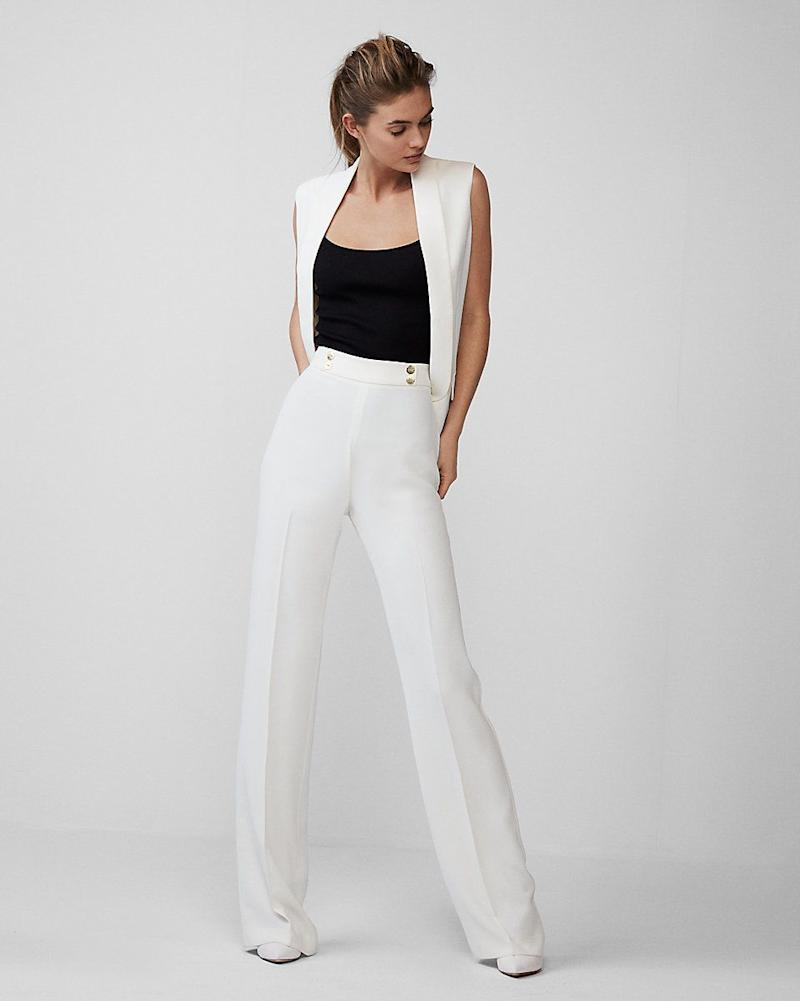 "Get it at <a href=""https://www.express.com/clothing/women/extreme-high-waisted-drape-wide-leg-dress-pant/pro/07439632/color/SOFT%20IVORY?mrkgcl=638&mrkgadid=3276578789&rkg_id=h-3fefc698f67eb1d5fa9587121bab3bf5_t-1520957583&CID=SEM_Goo-PLA-F-Qualified-Retail-92-000-Dress_Pants-US-Product-NA&SearchID=Goo-PLA-F-Qualified-Retail-92-000-Dress_Pants-US-Product-NA&product_id=13052614&adpos=1o4&creative=230497550586&device=c&matchtype=&network=g&gclid=Cj0KCQjw7Z3VBRC-ARIsAEQifZQs0LCxWFHAIiiZHDXn5xxw2Dn0HFjX06FOD8YnaikqQlsild-jbgcaAtKyEALw_wcB"" target=""_blank"">Express</a>, $70."